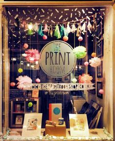 My lovely shop :) Fun new window display with pom poms and window drawing! www.theprintroomshop.co.uk #theprintroom