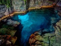 The Grotto—Bruce Peninsula National Park, Ontario: About four hours northwest of Toronto, water has eroded the shoreline's soft limestone, creating overhanging cliffs and deep sea caves, including the famed Grotto. After a 30-minute hike past fields of rare ferns and orchids, swimmers lower themselves down through a natural rock chimney and into the turquoise water below. The truly adventurous can then hold their breath, dive underwater, and continue through a sunlit tunnel out to the bay.