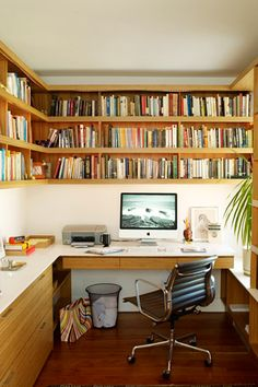 """10 Genius Design Tips To Make Your Small Space Look Bigger #refinery29 http://www.refinery29.com/living-archive-124#slide2 """"I really like wrapping books around the wall in an office space above where you'll be working. This office is cozy and has an ample work surface due to the smart built-in design.""""Photo: Courtesy of Apartment Therapy"""