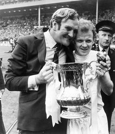 Leeds manager Don Revie with captain Billy Bremner hold the FA Cup trophy following their 1-0 victory over Arsenal in the Final at Wembley S...