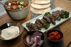 Cevapi: Balkan Grilled Minced Meat Cevapi: Balkan Grilled Minced Meat Cevapi: Balkan Grilled Minced Meat Cevapi: Balkan Grilled Minced Meat The tricks of cooking good meat. To cook meat a Dinner For One, Bulgarian Recipes, Croatian Recipes, Balkan Food, Burek Recipe, New York Sour, Macedonian Food, Ground Lamb, Ground Beef