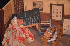 Vintage Miniature school room from Italy with teacher and student dolls plus interesting accessories such as miniature chalk board, bell, abacus, math charts etc.