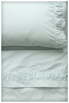 Love these soft blue sheets for a splash of color.