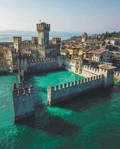 Medieval castle called Sirmione, its located in Italy.- Tanks that Get Around is an online store offering a selection of funny travel clothes for world explorers.tanksthatgeta… for funny travel tank tops and more travel bucket list inspo Romantic Destinations, Romantic Travel, Travel Destinations, New Travel, Italy Travel, Italy Vacation, Vacation Travel, Luxury Travel, Maldives Vacation