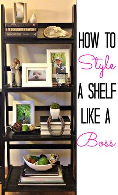 How to style a shelf like a boss- Choose a color scheme, layer shorter things in front of taller things for depth & complexity. Use books as pedestals, vary height & you can group them facing in or out. Start with Largest items first & disperse them evenly, then med & fill in with the smallest.: