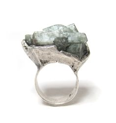 this decidedly delicious, enigmatic, ethereal and magical silver ring with a greenish blue beryl (also known as aquamarine) stone waves light from it's surface with it's complex and stunning hexagonal crystal system…. the lightness of summer, the coolness of winter. where to start… where to end… it takes many, many words—or no words at all—to …
