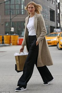 Karlie Kloss wearing Tiffany & Co. T Wire Bracelet and Adidas Campus Sneakers