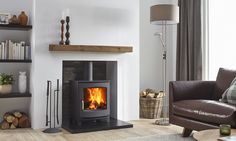 The Jens Keld 5 wood burning stove by Dik Geurts comes in two sizes; High and Low. The Keld Low is a great addition to an existing fireplace chamber due to it's 'snug' structure and shallow depth. The Keld High raises the stove up by which allows Stove Prices, Home Decor Kitchen, House, Home, Pellet Stove, Wood Burning Stoves Living Room, Fireplace, Home Decor, Wood Stove