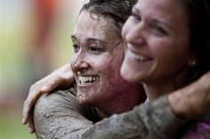 Dirt don't hurt    Trisha Loede, left, hugs Ann Mitchell after completing the Women's History Month Ultimate Dirty Dash at Incirlik Air Base, Turkey, March 31, 2012. Seventy-five teams participated in the event, which gave members of the base a chance to compete in physical activities while answering women's history trivia questions. Loede is with the 39th Air Base Wing and Mitchell is with the 39th Force Support Squadron. (U.S. Air Force photo by Senior Airman Clayton Lenhardt)