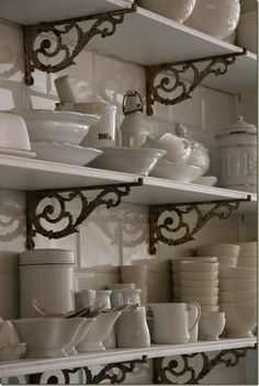 Vintage brackets- nice...Open shelving, vintage brackets, subway tiles, white dishware all make for a yummy package. This photo inspired a similar thing i am doing with vintage brackets behind the sink.