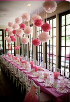 Little girl birthday party. Love the poofs hanging from the ceiling <3