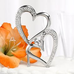 """Sparkling Love Cake Pick Cake Topper- Nickel-plated cake pick with double heart design, sparkling rhinestone accents and large center rhinestone. 7"""" tall, 2"""" picks for inserting into cake. #WeddingDresses #WeddingRings #WeddingGifts #Wedding #WeddingIdeas"""