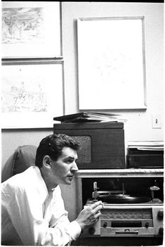 Leonard Bernstein [Leonard Bernstein listening to records.]