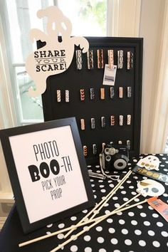 We hosted an afternoon kids' Halloween party with a modern twist by painting pumpkins for decor (great to display around the home after the party) and setting up candy cornhole, a photo booth and a bubble station