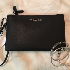 Fabulous Black Leather Calvin Klein Clutch This fabulous black leather Calvin Klein double clutch is sure to wow! The textured feel and silver hardware only add to its gorgeous design. Handle to use as a wristlet, or attach to a larger bag. Slip pocket for storing your essentials. Simply lovely. Gorgeous with the sleeveless Calvin Klein dress in my closet. You don't want to miss that listing ladies! It's fab!! Free gift with purchase. Calvin Klein Bags Clutches & Wristlets
