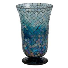 Shining Seas Mosaic Vase, $39 — This mosaic vase is made by artisans in Moradabad, India. The glass chips are recycled glass, taken from old bottles and other glass items. They are cleaned and colored before use in this shimmery vase. #FairTrade #Gift #FairTradeHome