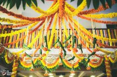 Magic with marigold   DIY decor ideas for the wedding house   Marigold string canopy for the aangan  Curated By Witty Vows