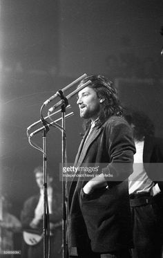 At the Milk Music Awards in the National Concert Hall Bono of U2, with The Edge behind him. U2 won: Best International Group, Best Irish Group, and Best Irish Album for 'The Unforgettable Fire.' 13/3/86. 386-243 (Part of the Independent Newspapers Ireland/NLI Collection).