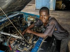 Mozambique travel memories. Teo's car mechanic. . Africa 2011 . . #africa #mozambique #moçambique #travelphotography #memories #trip #africaday #blackheart #saudade #portuguese #portugal #maninguenice #street #ontheroad #roadtrip #volunteer #love #life #igersafrica #visitafrica #opportunity #better #conditions #mechanic #car #afriquedusud #young #boy