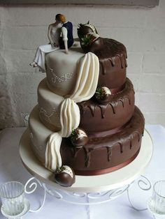 Today's Wedding Cake was a new challenge - a half and half cake; one half chocolate icing, the other ivory white.  The chocolate half covered in cascading melted chocolate, the ivory half decorated with delicate piping detail, topped off with chocolate dipped strawberries and draping work to cover the seams (which was a first for me).  I was a little scared of this one, but I took each section at a time, and am really pleased with the outcome.