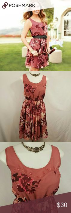 🆕 Lauren Conrad Pink Floral Dress Size 6 Beautiful pink Chiffon dress from Lauren Conrad. Embroidered on the top along the neckline, elastic waist. 100% polyester and fully lined. In great condition. No belt included but does have belt loops. Lauren Conrad  Dresses Midi