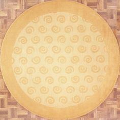 HANDMADE ROUND AREA RUG 8X8 IN GOLD WITH CIRCULAR SWIRL PATTERNS Handmade and tufted circular area rug with circular swirl patterns in gold, 8x8. Imported from India with wool. Free Shipping within the US.