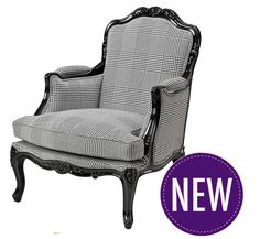 Classic black and white dogtooth pattern upholstered armchair from Eichholtz. The French chair features a monochrome dogtooth pattern upholstered fabric, wooden legs in dark rich black, and intricate classic ornate detailing to the frame and legs. Dimensions: W 72 cm, D 63 cm, H 94 cm, Seat Height 41 cm, Arm Height 62 cm