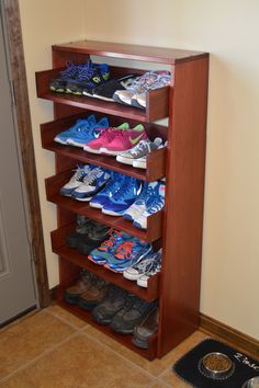 Wood shoe rack: made from reclaimed redwood, screws and some Varathane poly/stain blend.