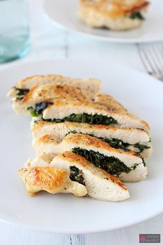 Greek-inspired Spinach and Feta Stuffed Chicken is delightfully juicy and flavorful. Have this gourmet chicken recipe on your dinner table in 30 minutes!