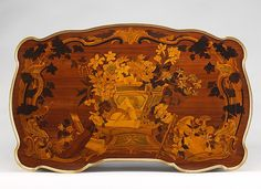 Mechanical table  Maker:Jean-François Oeben (French, born Germany, Heisenberg 1721–1763 Paris) Maker: and Roger Vandercruse, called Lacroix (French, 1727–1799) Date:ca. 1761–63 Culture:French Medium:Oak veneered with mahogany, kingwood, and tulipwood, with marquetry of mahogany, rosewood, holly, and various other woods; gilt-bronze mounts; imitation Japanese lacquer; replaced silk