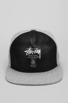 285c44dba9a Awesome faux leather snapback hat from Stussy.  urbanoutfitters Leather  Snapback