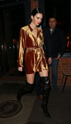 Kendall Jenner wearing a bronze velvet ALC dress and thigh-high Tom Ford boots.
