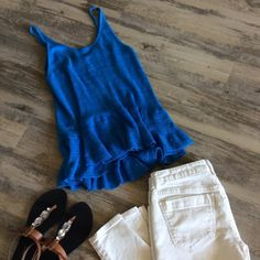 Blue Sweater Tank This tank is a vibrant blue color with great subtle peplum detail at the bottom.  It features spaghetti straps and is a lightweight sweater material. Hinge Tops Tank Tops