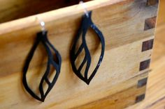 Bike tubes made into leaf earrings. So do-it-yourself and re-purposing.
