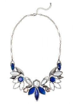 A beautiful statement necklace that features a cluster of blue stones paired with rhinestones shaped into lotus petals to make this piece the focal point. Pair this piece with a white cocktail dress.