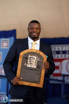 and his Hall of Fame plaque. Mariners Baseball, Seattle Mariners, Nationals Baseball, Batting Gloves, Ken Griffey, Sport Icon, One Team, Kids, Cheap Tickets