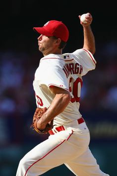 Starter Adam Wainwright pitches against the Philadelphia Phillies in the eighth inning. Cards won 4-1. 6-21-14