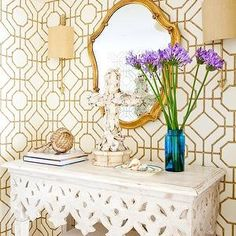 Marjorie Johnston and Co. - entrances/foyers - bamboo wallpaper, cowtan and tout wallpaper, gold bamboo wallpaper, white and gold wallpaper, gold mirror, gold leaf mirror, antique brass sconce, carved wood console table, whitewashed console table, white carved wood console table, ottoman, slipcovered ottoman, turquoise vase, books, seashells, Cowtan and Tout Bamboo Wallpaper,
