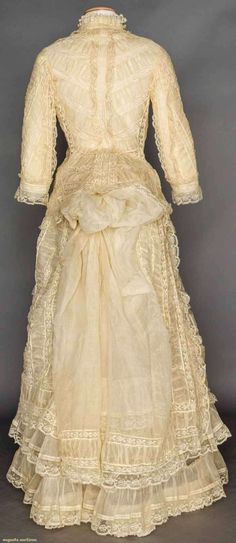 Cream organdi and lace bustle dress, 2-piece, ruched organday bands alternate wIth Valenciennes lace, tubular sleesves on cuirass bodice & narrow bell skirt, 1870s