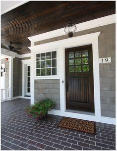 Exterior Double Door Trim solid wood double door with wrought iron. porch overhang. stone