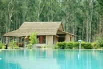 In the north Himalayan-state of Uttarakhand, the ancient land of gods and goddesses, the once-favoured hunting ground of Indian nobility and English gentry, lies Jim's Jungle Retreat, bordering the spectacular 1,300 sq km Corbett Tiger Reserve.