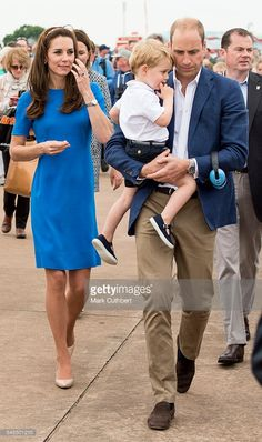 Prince William, Duke of Cambridge and Catherine, Duchess of Cambridge with Prince George of Cambridge during a visit to The Royal International Air Tattoo at RAF Fairford on July 8, 2016 in Fairford, England.  (Photo by Mark Cuthbert/UK Press via Getty Images)