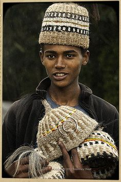 handsome young man sells traditional hats in the hills above Addis Ababa, Ethiopia Cultures Du Monde, World Cultures, We Are The World, People Around The World, Population Du Monde, Ethiopian People, Ethiopian Tribes, Horn Of Africa, Addis Ababa