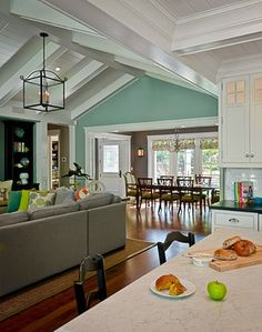Great flow of colors from dining room to living room. Blue color is Benjamin Moore: HC-142 Stratton Blue in Eggshell Grey color is Benjamin Moore: HC-167 Amherst Grey in Eggshell.