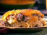 Sausage, strata, potatoes & cheese come together to make the most amazing breakfast casserole ever.