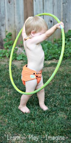 Gross motor activities with a hula hoop that even a toddler can do!