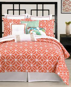 Teal and coral bedspread. Holly likes it :)