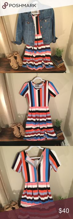 LuLaRoe Amelia Dress in Colorful Stripe Love this! This Amelia can be worn multiple ways, zipper on back or front- also has pockets! The perfect brunch outfit, who wouldn't love to drink mimosas in this?! (Ps I've done it, and it was awesome)  Worn twice! LuLaRoe Dresses