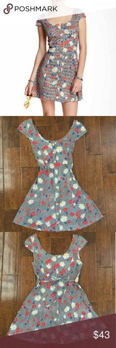 Mink Pink Floral Dress Only worn once so like new. Great condition throughout and can tie the waist how you want, to show off your figure. Great for the upcoming spring. Goes about mid thigh. Feel free to ask questions or bundle. MINKPINK Dresses Mini
