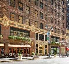 """#LibraryHotel main entrance is located on 41st Street, known as """"Library Way"""" and features 100 bronze plaques with famous literary quotes."""